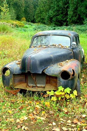 rusted: OLD BLACK RUSTED CAR