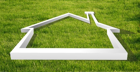 economic rent: White house outline in the grass for real estate, financial or family themes