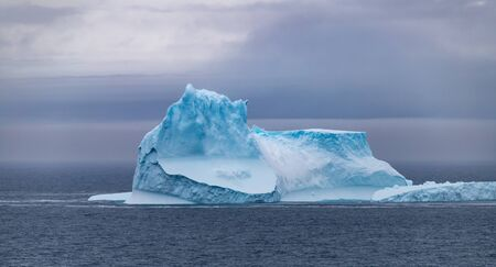 Icebergs floating in the Antarctic after calving off the numerous glaciers in the area.