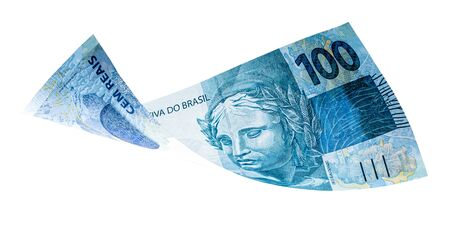banknote of one hundred reais from brazil falling on isolated white background