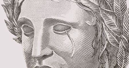 detail of the Brazilian money bill, real, crying, tears streaming down her face. Concept of Brazilian social and financial crisis.