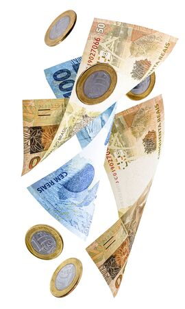 money from Brazil falling, notes of one hundred reais and fifty reais with coins of one real, falling. Brazil's financial crisis, devaluation of the real.