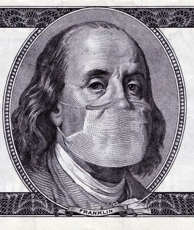 COVID-19 Coronavirus pandemic in the USA, $ 100 cash note with face mask. Virus outbreak had slowed the world economy, united states in health crisis.