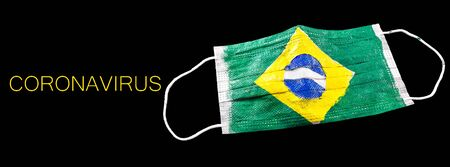 disposable breathing mask, used to prevent coronavirus at home. Home quarantine brazil concept. Brazil covid crisis 19