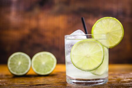 Caipirinha, a typical Brazilian cocktail made with lemon, cachaça and sugar. Brazilian traditional drink, isolated with space for text. Archivio Fotografico