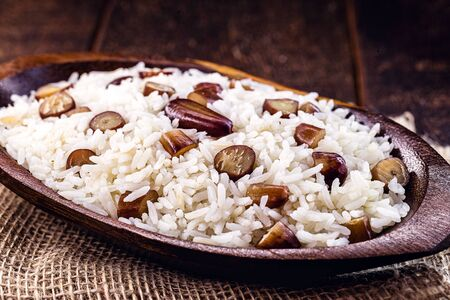 rice with pine nuts, typical Brazilian food during the winter. Meal made with pinaceaes and araucariaceaes, served hot. IN Brazil it is called