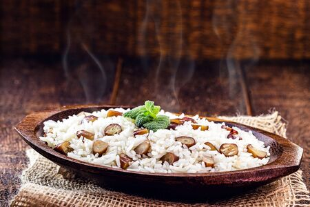 "rice with pine nuts, typical Brazilian food during the winter. Meal made with pinaceaes and araucariaceaes, served hot. IN Brazil it is called ""pinhaõ"" rice"