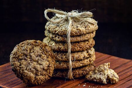 home made homemade cookie stacked on rustic wooden background. Space for text. Archivio Fotografico
