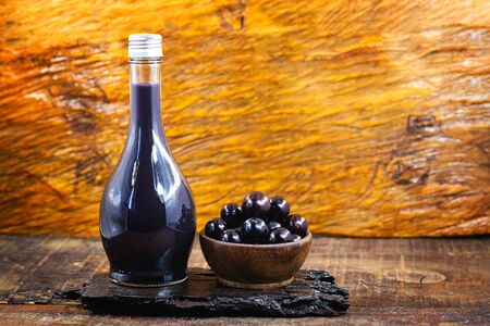 Jabuticaba liqueur, fruit of jabuticabeira, a Brazilian fruit tree. Common alcoholic drink in brazil, brazilian alcoholic drink. Gastronomic tourism.