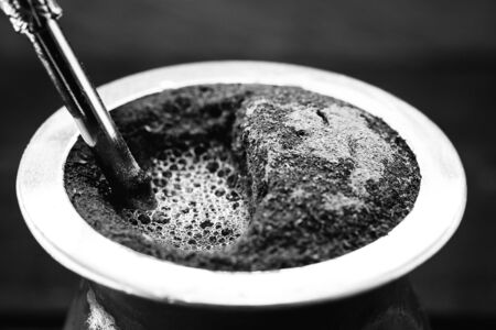 A typical Brazilian drink, o chimarrão, or mate, is a character, Black and white photography, drink in black and white. South American Tradition.