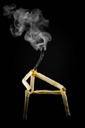 Concept of weakness or lonely. Image of a man made of matchstick. Small and depressive in the dark, erased and losing the flame.