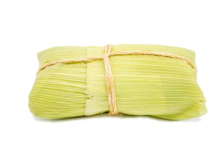Brazilian pamonha on white background, typical dessert of the rural cities of Brazil. Sweet corn with cheese served in the straw. Rural sweets made in the states of Minas Gerais and Goiais. 版權商用圖片