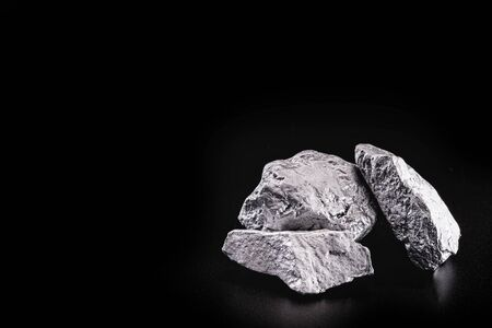silver nugget native to Liberia isolated on black background.