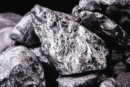 chrome stone extracted from mine, isolated black background.