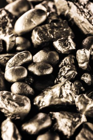 gold texture, many gold nugget, stone of value. Crude gold drawn on black background. Concept of wealth or luxury. Stock Photo
