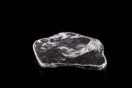 Rhodium nugget, chemical element with Rh symbol, metal for industrial use, used in jewelry and automatic equipment.