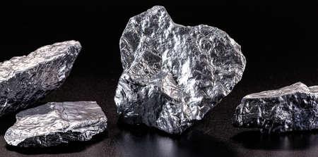 Chrome elemental specimen sample isolated on black background, mining and gemstone concept.