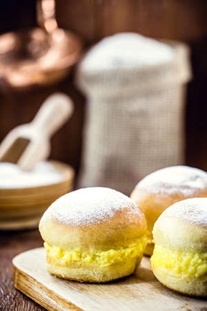 """bread with cream and sugar, Brazilian donut called """"bakery dream"""", or berlin ball."""