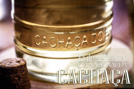 "Brazilian drink called ""cachaça"" or ""pinga"", traditional distilled drink from Brazil, with text in Portuguese: September 13th, national day of cachaça"
