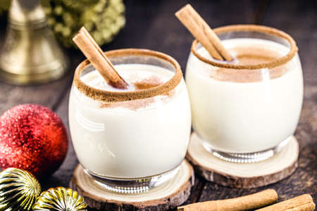hot eggnog typical of Christmas, made at home all over the world, based on eggs and alcohol. called eggnog, Auld Man's milk, milk and pisco, momo cola, coquito or Crème de Vie or Eierlikör 写真素材