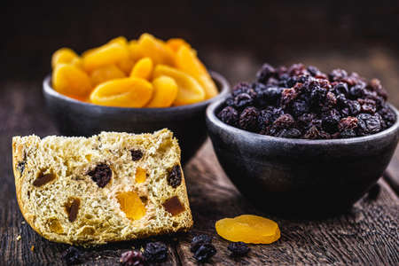 pot of brazilian raisin, candied fruit used in sweets, with slice of breadpan in the bottom, inside a handmade clay pot Archivio Fotografico