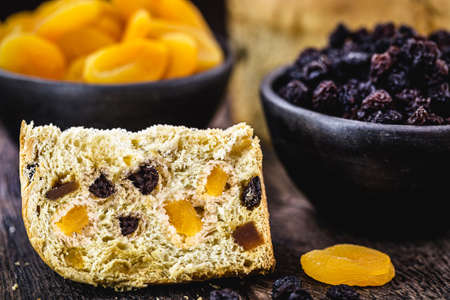 large slice of panettone, typical candied fruit bread, a Brazilian and Italian Christmas dessert Stock Photo