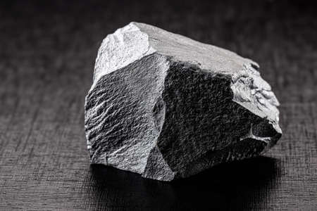 iron ore stones, on isolated black background, used in industry, iron ore for export and import.