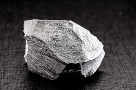 iron ore stones, on isolated black background, used in industry, Chinese iron ore for export and import.