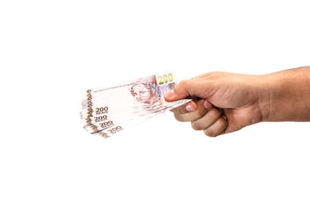 hand holding two hundred reais bank notes, brazil money, payment concept, grand prize or profit