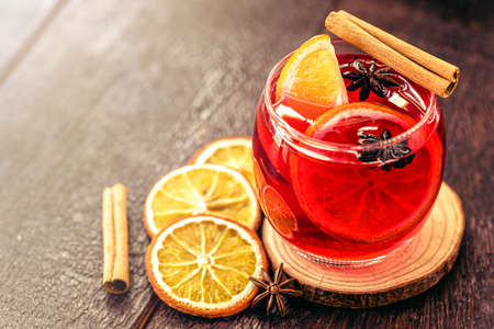 Spanish sangria, hot winter drink served at Christmas and New Year. Christmas colors and lights, party.