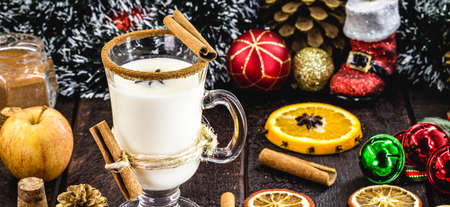 warm homemade eggnog typical of Christmas, hot winter drink and year-end parties.