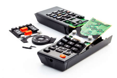 broken remote control, smashed, broken and obsolete television control. technology used, technological waste