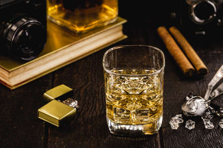 square glass with whiskey and ice, high quality distilled beverage