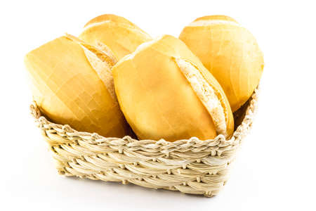 """A basket full of traditional Brazilian bread, called """"French Bread Cacetinho"""", traditional concept of Brazilian food, isolated white background"""