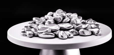 platinum stones, small silver metal nuggets on electronic scale