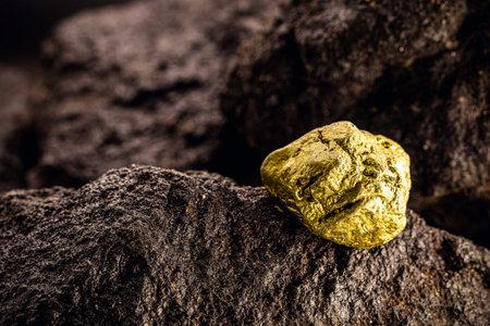 gold on rock, golden nugget on cave wall, gold mining Reklamní fotografie