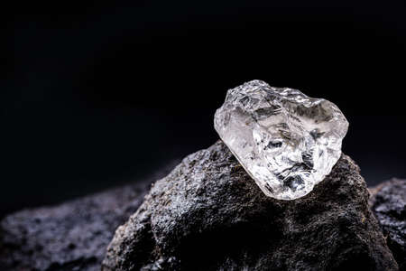 Rough diamond, precious stone in mines. Concept of mining and extraction of rare ores.