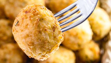 fried dumpling on the fork, cod dumpling, fish meat, spot focus