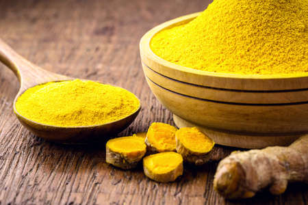 spoonful of turmeric powder, Indian culinary spice