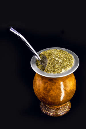 hot chimarrão, with isolated black background, typical drink from Brazil