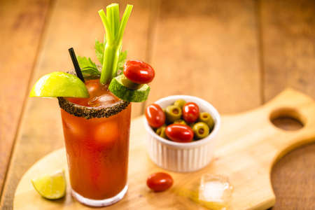 Canadian Caesar drink, typical Canadian drink, with hot sauce, celery, lemon, vodka and ice