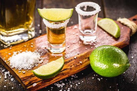 mexican drink tequila being prepared, salt and lemon, distilled latin drink Stock Photo