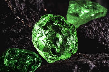 raw emerald gem in rare stone mine, bright green stone