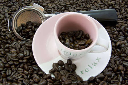 Coffee cup with freshly roasted coffee beans Stock Photo