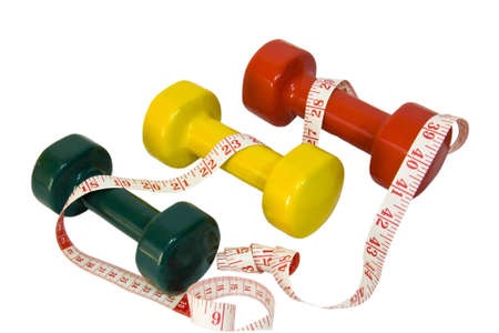Hand weights with tape measure depicting fitness Stock Photo