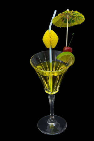 Pineapple and vodka cocktail isolated on black background