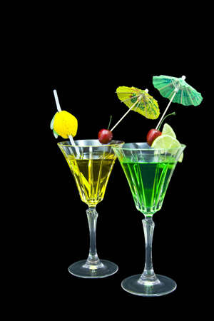 Two decorated cocktails isolated on black background