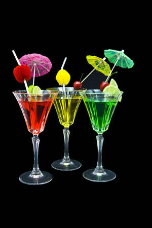 Three cocktails decorated isolated on black background