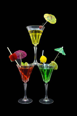 Three stacked cocktails isolated on black background