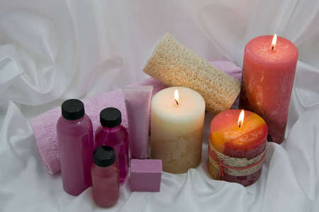 Spa items with lighted candles on soft background